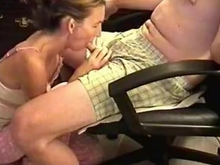 She was a bit shy 'cuz the camera was shooting, but also horny. I sat in an armchair and this babe knelt in front to wrap her lips around my cock. Then, this babe performed one of the best blowjobs ever.