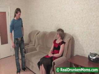 Drunk mamma with a younger boy begins to fuck and then passes out